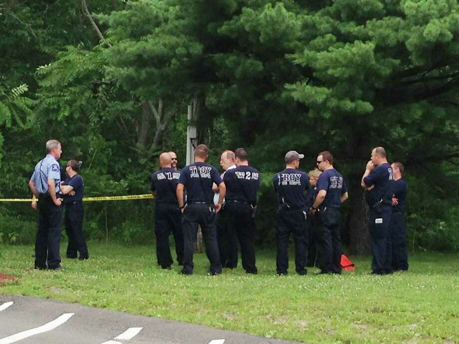 Troy fighters stand at the scene of where a body was found in the Wynant Skill, just east of Burden Lake by Campbell Ave. Wednesday, July 3, 2013, in Troy, N.Y. (Lori Van Buren/Times Union)