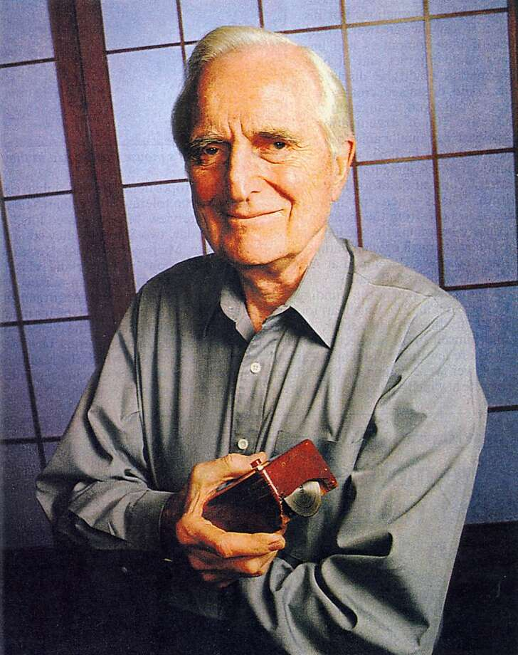 Mr. Engelbart with his mouse prototype.