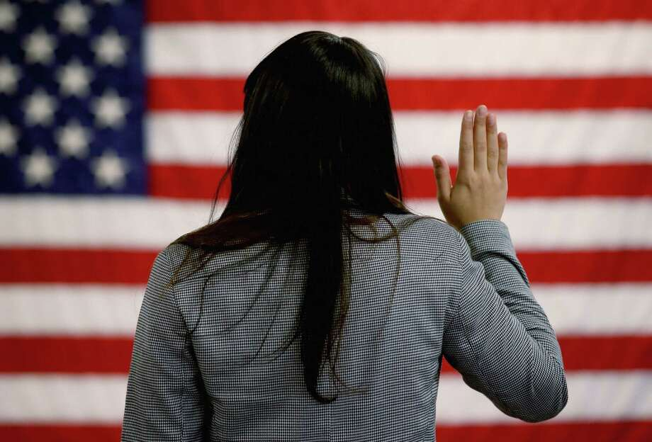 The path to citizenship is far more complex than going to the back of the line, paying taxes and learning English, as New Hampshire Republican Sen. Kelly Ayotte recently ordered. Photo: John Moore / Getty Images