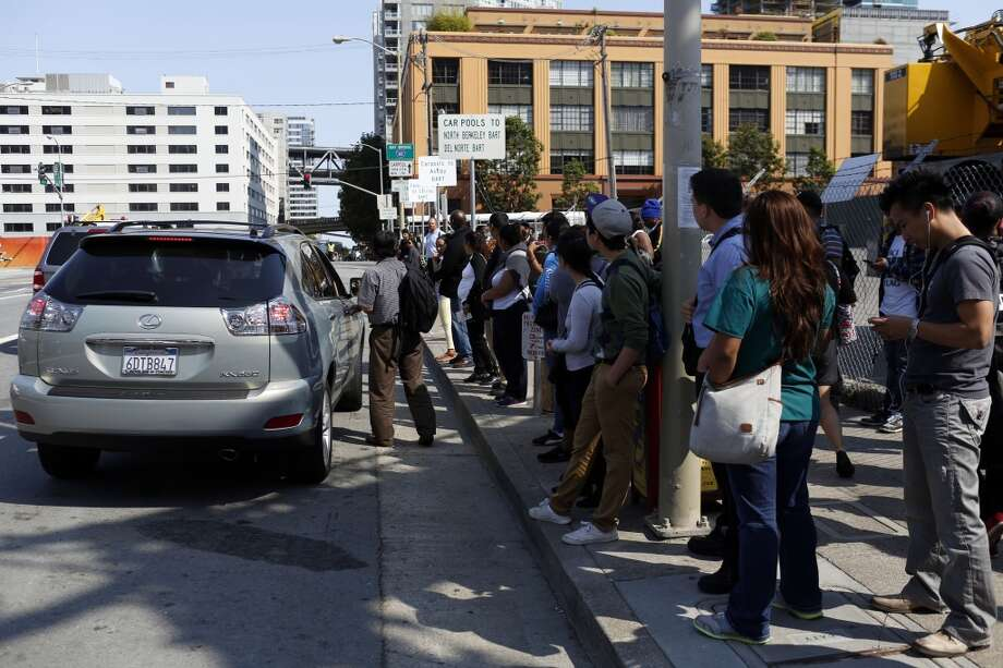 People wait at carpool pickup stops on Beale Street while BART workers are on strike in San Francisco, Calif. on July 1, 2013.