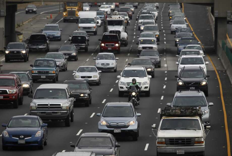Commuters, even carpoolers travelling in the diamond lane (right), are stuck in bumper-to-bumper traffic as they approach the MacArthur Maze on the Eastshore Freeway in Berkeley, Calif. on Wednesday, July 3, 2013.