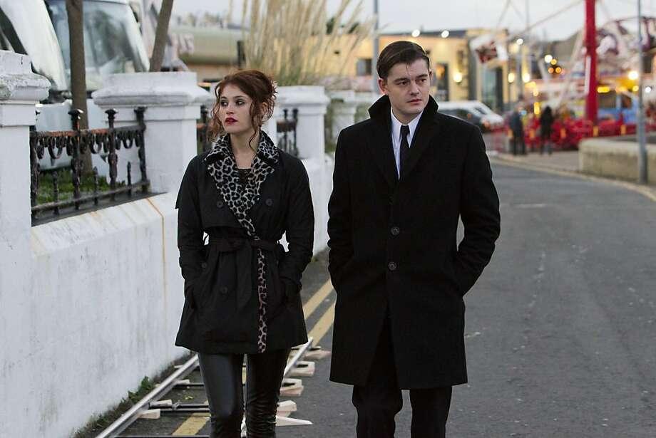 "The treatment of Clara (Gemma Arterton) prompts Darvell (Sam Riley) to try to intervene in ""Byzantium,"" a flashback-laced vampire tale from Neil Jordan. Photo: Patrick Redmond, IFC Films"