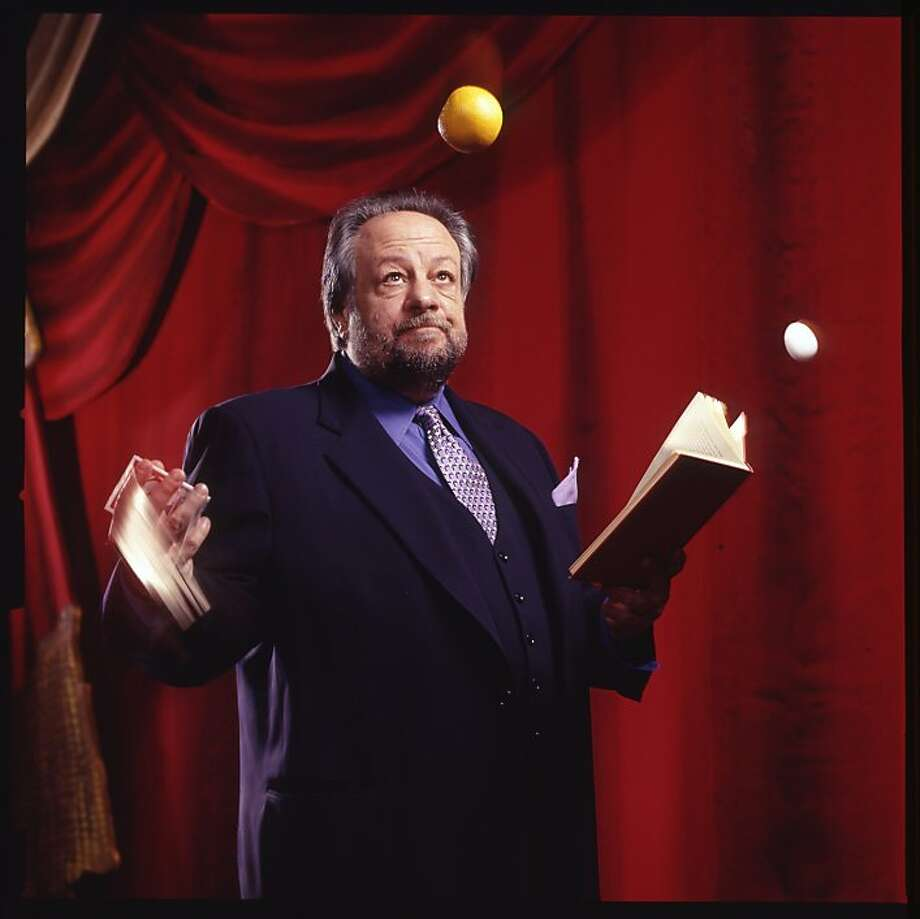 You see the magician Ricky Jay in,