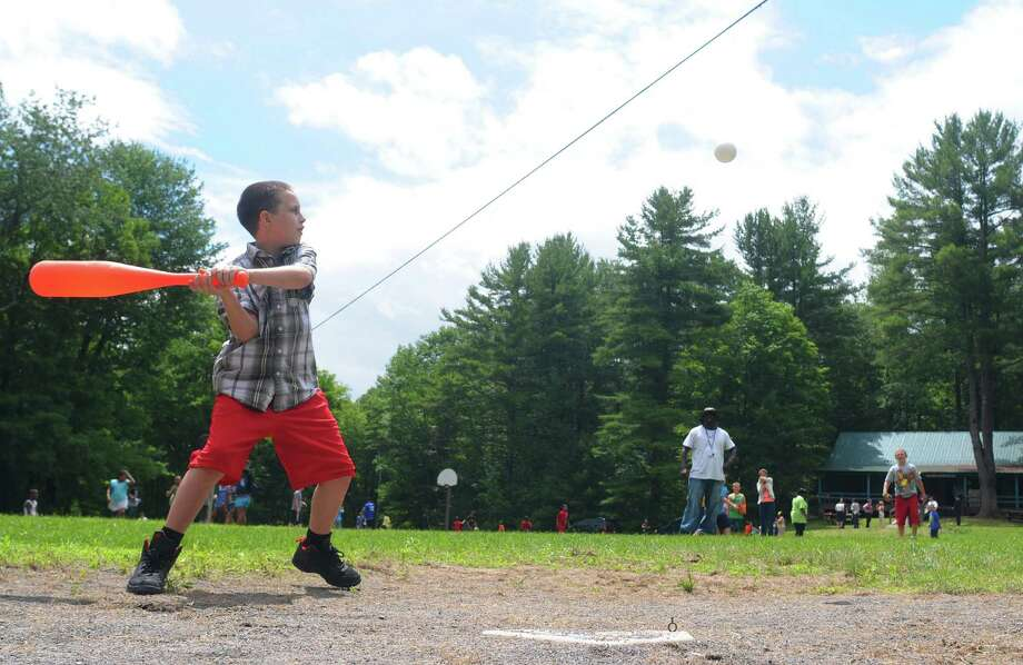 Children and camp counselors take part in a baseball game at Lawson Lake Park on Wednesday, July 3, 2013, in Coeymans, N.Y.  (Paul Buckowski / Times Union) Photo: Paul Buckowski / 00023041A
