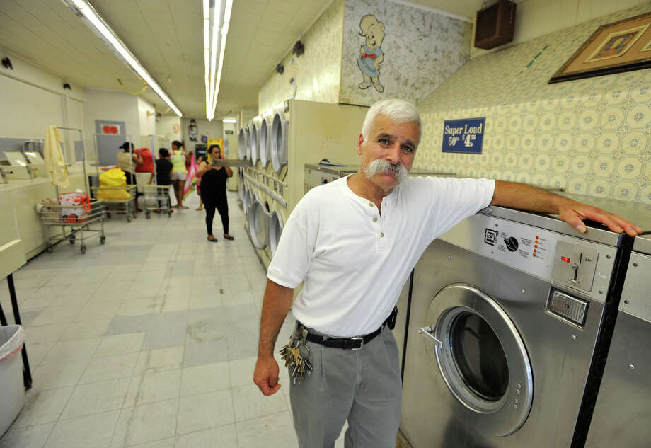 Mike Guroian, owner of Mike's Megamat in Stamford, has been in the laundromat business in Stamford since 1979. Photographed on Wednesday, July 3, 2013. Guroian is strugglng to decide whether to update his early 1990's era washers and dryers because the city increased the personal property tax, which includes equipment his business owns. Photo: Jason Rearick / Stamford Advocate