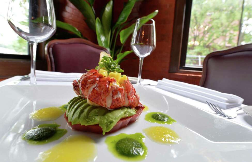 Chilled Maine lobster with heirloom tomato, avocado, mango, basil puree, and crostini is plated at Javier's Thursday, June 27, 2013, in Saratoga Springs, N.Y. (Skip Dickstein/Times Union)