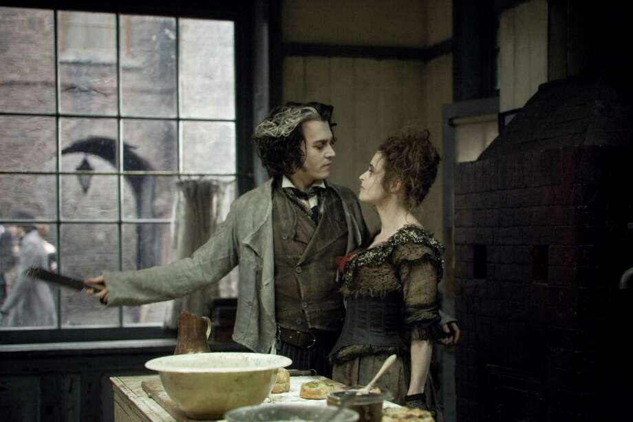 LEAH GALLO/DREAMWORKS THE VENGEFUL Sweeney Todd (Johnny Depp) and his willing accomplice Mrs. Lovett (Helena Bonham  Carter) conspire in ''Sweeney Todd: The Demon Barber of Fleet Street.'' Photo: Photo Credit: Leah Gallo
