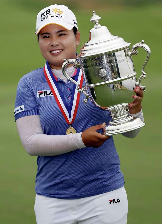 Inbee Park, of South Korea, holds the championship trophy after winning the U.S. Women's Open golf tournament Sunday. Photo: Frank Franklin II, STF / AP