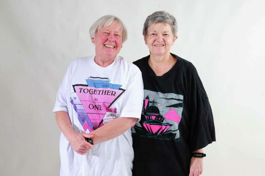 Martha Schultz, left, and Cheryl Reeves, right, of Lansingburgh are pictured Wednesday, June 26, 2013, in Colonie N.Y., wearing T-shirts they wore in a 1993 gay pride rally in Washington D.C. (Will Waldron/Times Union) Photo: Will Waldron / 00022930A