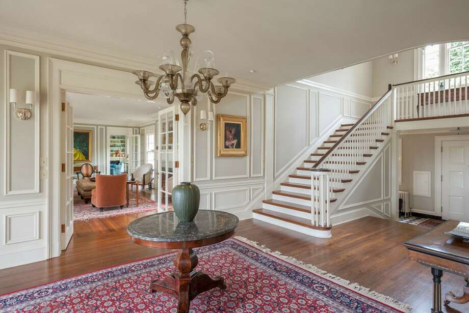 Entry of 260 39th Ave. E., in Denny-Blaine. The 10,690-square-foot mansion, built in 1921, has seven bedrooms, 5.5 bathrooms, a sunroom, a two-story library, five fireplaces, French doors, an elevator, a wine cellar, a recreation room, a patio and a pool on more than three-quarters of an acre. It's listed for $6.78 million. Photo: Courtesy Virginia And Whitney Mason, Coldwell Banker Bain