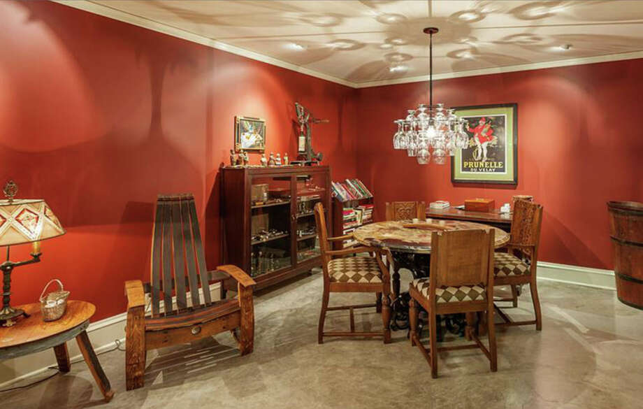 Recreation room of 260 39th Ave. E., in Denny-Blaine. The 10,690-square-foot mansion, built in 1921, has seven bedrooms, 5.5 bathrooms, a grand entry, a sunroom, a two-story library, five fireplaces, French doors, an elevator, a wine cellar, a patio and a pool on more than three-quarters of an acre. It's listed for $6.78 million. Photo: Courtesy Virginia And Whitney Mason, Coldwell Banker Bain