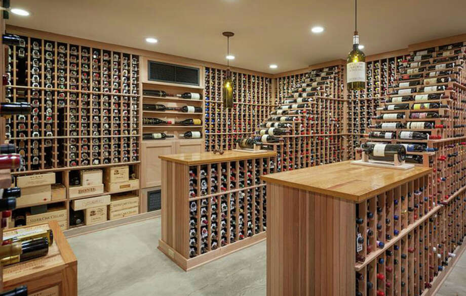 Wine cellar, a recreation room of 260 39th Ave. E., in Denny-Blaine. The 10,690-square-foot mansion, built in 1921, has seven bedrooms, 5.5 bathrooms, a grand entry, a sunroom, a two-story library, five fireplaces, French doors, an elevator, a recreation room, a patio and a pool on more than three-quarters of an acre. It's listed for $6.78 million. Photo: Courtesy Virginia And Whitney Mason, Coldwell Banker Bain