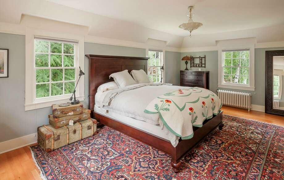 Bedroom of 260 39th Ave. E., in Denny-Blaine. The 10,690-square-foot mansion, built in 1921, has seven bedrooms, 5.5 bathrooms, a grand entry, a sunroom, a two-story library, five fireplaces, French doors, an elevator, a wine cellar, a recreation room, a patio and a pool on more than three-quarters of an acre. It's listed for $6.78 million. Photo: Courtesy Virginia And Whitney Mason, Coldwell Banker Bain