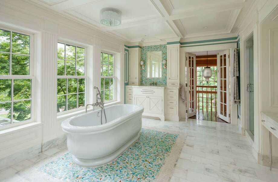 Master bathroom of 260 39th Ave. E., in Denny-Blaine. The 10,690-square-foot mansion, built in 1921, has seven bedrooms, 5.5 bathrooms, a grand entry, a sunroom, a two-story library, five fireplaces, French doors, an elevator, a wine cellar, a recreation room, a patio and a pool on more than three-quarters of an acre. It's listed for $6.78 million. Photo: Courtesy Virginia And Whitney Mason, Coldwell Banker Bain