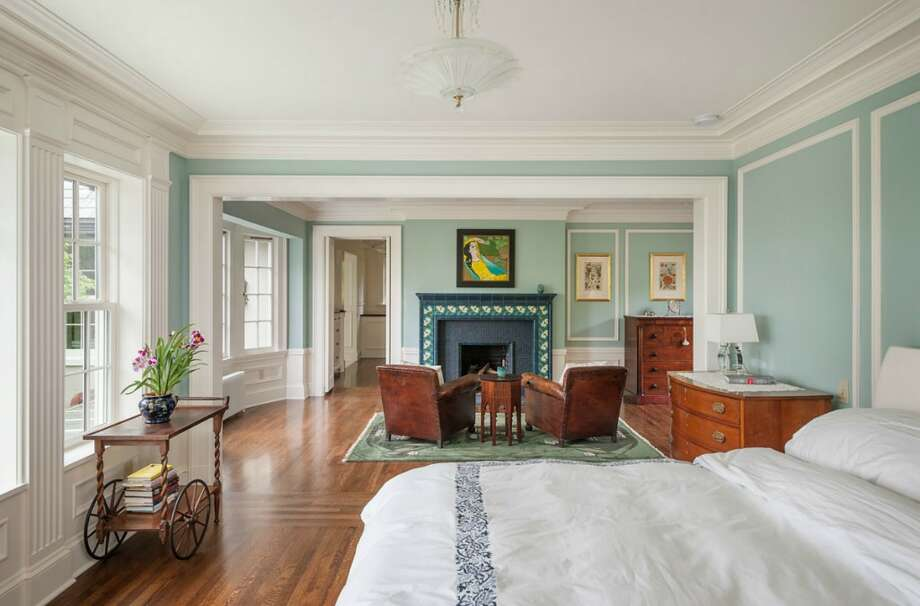 Master bedroom of 260 39th Ave. E., in Denny-Blaine. The 10,690-square-foot mansion, built in 1921, has seven bedrooms, 5.5 bathrooms, a grand entry, a sunroom, a two-story library, five fireplaces, French doors, an elevator, a wine cellar, a recreation room, a patio and a pool on more than three-quarters of an acre. It's listed for $6.78 million. Photo: Courtesy Virginia And Whitney Mason, Coldwell Banker Bain