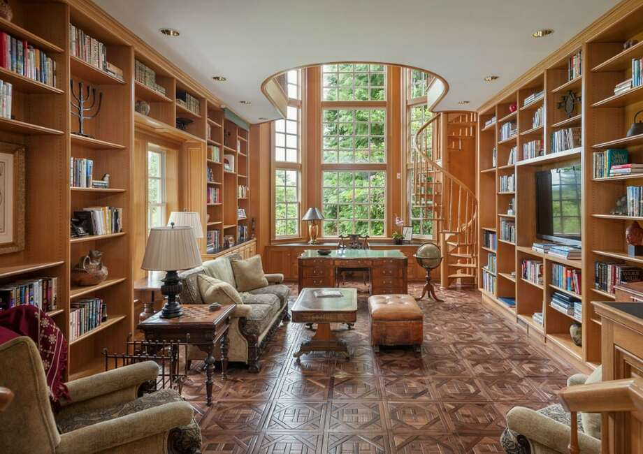 Library of 260 39th Ave. E., in Denny-Blaine. The 10,690-square-foot mansion, built in 1921, has seven bedrooms, 5.5 bathrooms, a grand entry, a sunroom, five fireplaces, French doors, an elevator, a wine cellar, a recreation room, a patio and a pool on more than three-quarters of an acre. It's listed for $6.78 million. Photo: Courtesy Virginia And Whitney Mason, Coldwell Banker Bain