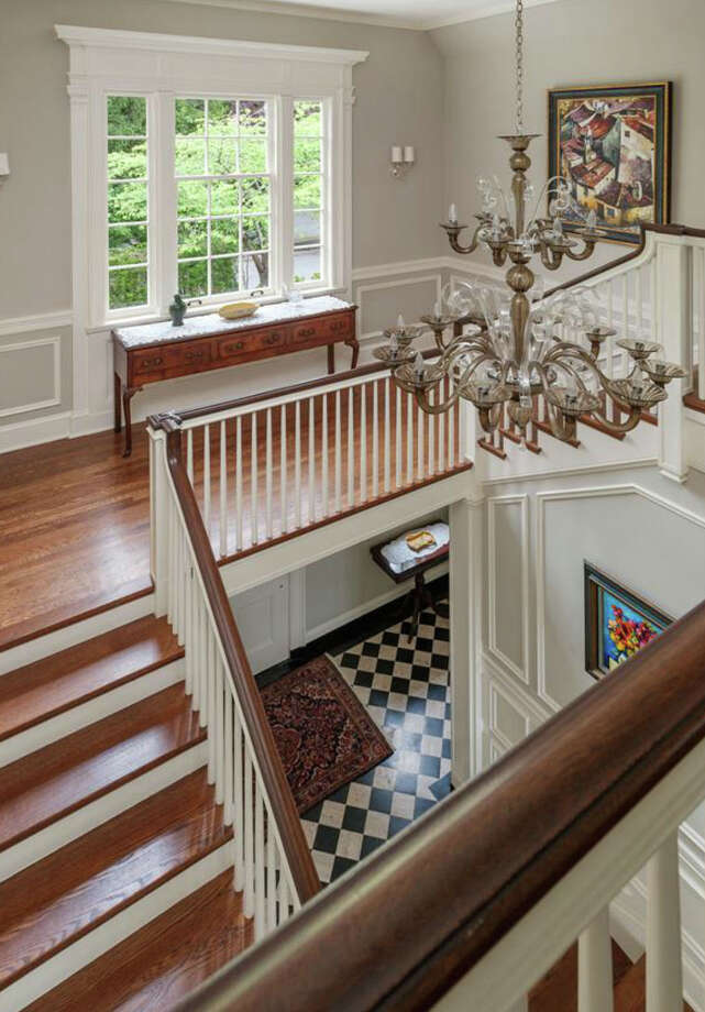 Staircase of 260 39th Ave. E., in Denny-Blaine. The 10,690-square-foot mansion, built in 1921, has seven bedrooms, 5.5 bathrooms, a grand entry, a sunroom, a two-story library, five fireplaces, French doors, an elevator, a wine cellar, a recreation room, a patio and a pool on more than three-quarters of an acre. It's listed for $6.78 million. Photo: Courtesy Virginia And Whitney Mason, Coldwell Banker Bain