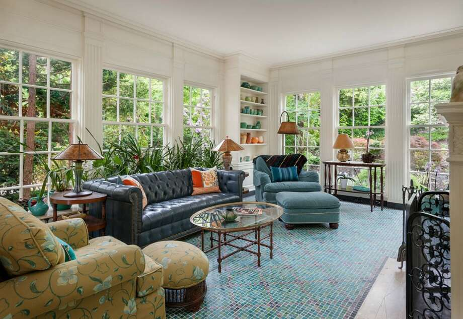 Sunroom of 260 39th Ave. E., in Denny-Blaine. The 10,690-square-foot mansion, built in 1921, has seven bedrooms, 5.5 bathrooms, a grand entry, a two-story library, five fireplaces, French doors, an elevator, a wine cellar, a recreation room, a patio and a pool on more than three-quarters of an acre. It's listed for $6.78 million. Photo: Courtesy Virginia And Whitney Mason, Coldwell Banker Bain