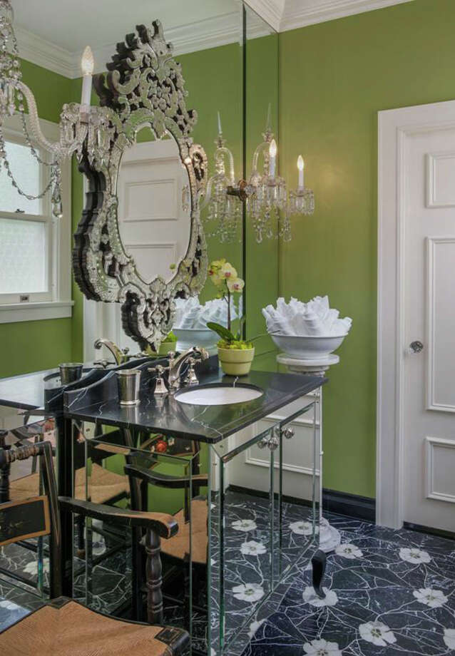 Powder room of 260 39th Ave. E., in Denny-Blaine. The 10,690-square-foot mansion, built in 1921, has seven bedrooms, 5.5 bathrooms, a grand entry, a sunroom, a two-story library, five fireplaces, French doors, an elevator, a wine cellar, a recreation room, a patio and a pool on more than three-quarters of an acre. It's listed for $6.78 million. Photo: Courtesy Virginia And Whitney Mason, Coldwell Banker Bain
