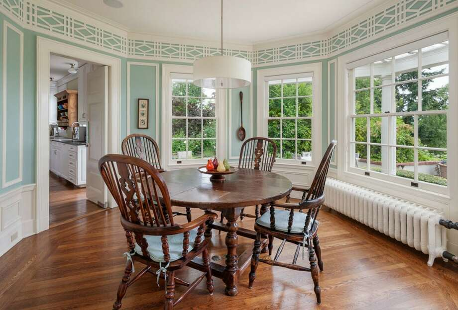 Breakfast room of 260 39th Ave. E., in Denny-Blaine. The 10,690-square-foot mansion, built in 1921, has seven bedrooms, 5.5 bathrooms, a grand entry, a sunroom, a two-story library, five fireplaces, French doors, an elevator, a wine cellar, a recreation room, a patio and a pool on more than three-quarters of an acre. It's listed for $6.78 million. Photo: Courtesy Virginia And Whitney Mason, Coldwell Banker Bain