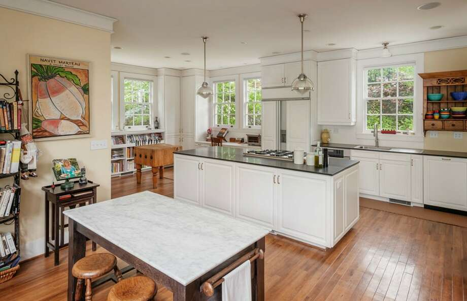 Kitchen of 260 39th Ave. E., in Denny-Blaine. The 10,690-square-foot mansion, built in 1921, has seven bedrooms, 5.5 bathrooms, a grand entry, a sunroom, a two-story library, five fireplaces, French doors, an elevator, a wine cellar, a recreation room, a patio and a pool on more than three-quarters of an acre. It's listed for $6.78 million. Photo: Courtesy Virginia And Whitney Mason, Coldwell Banker Bain