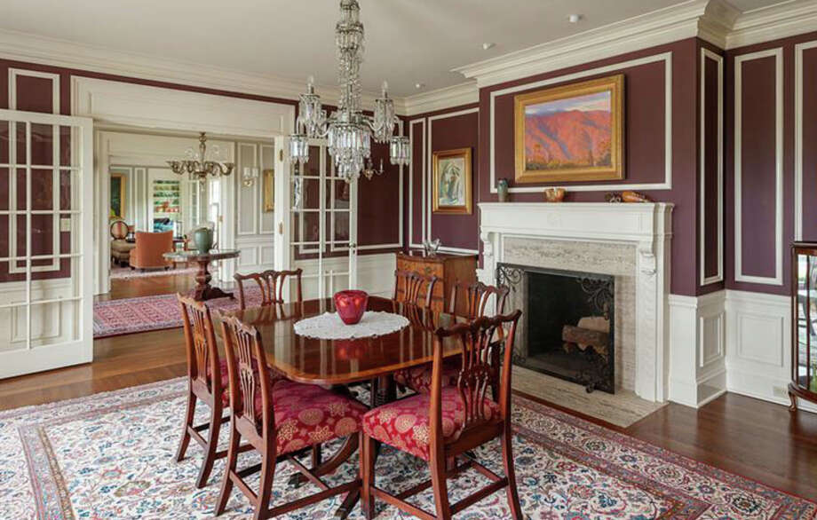 Dining room of 260 39th Ave. E., in Denny-Blaine. The 10,690-square-foot mansion, built in 1921, has seven bedrooms, 5.5 bathrooms, a grand entry, a sunroom, a two-story library, five fireplaces, French doors, an elevator, a wine cellar, a recreation room, a patio and a pool on more than three-quarters of an acre. It's listed for $6.78 million. Photo: Courtesy Virginia And Whitney Mason, Coldwell Banker Bain