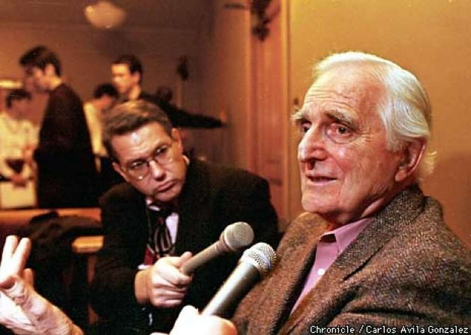 Doug Engelbart, creator of the computer mouse, speaks with the media at a symposium celebrating the 30th anniversary of the creation of the computer device, on Wednesday, December 9, 1998, at Stanford University.