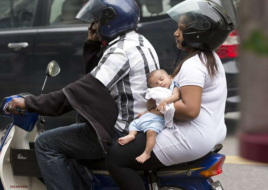 Zzz-ee rider: A young rider sleeps through the morning commute in Kuala Lumpur. Photo: Mark Baker, Associated Press
