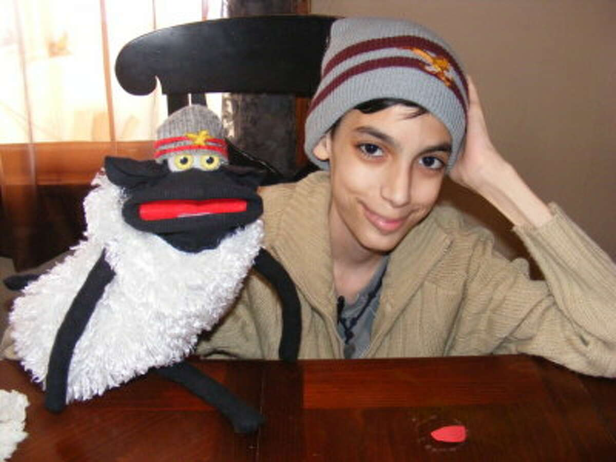 Connor Moran poses at his home in Wynantskill with a puppet he made. (Laura Smith)