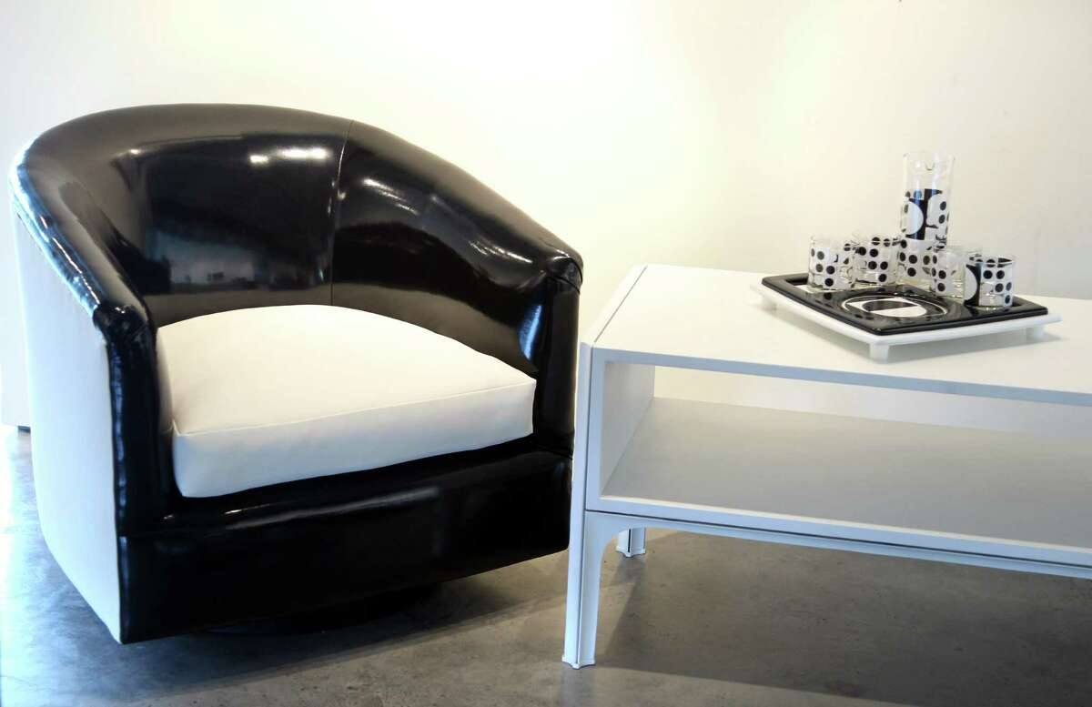 A Milo Baughman chair in patent leather.