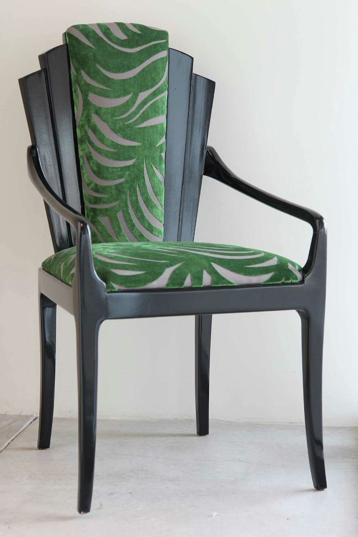 A Vladimir Kagan chair from the 1940s reupholstered in an emerald velvet fabric.