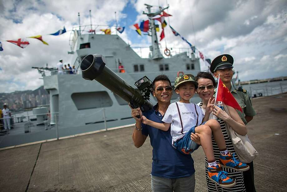 Dad goes ballistic: Some families are apparently providing their own fireworks for the Special Administrative Region Establishment Day holiday celebration in a Hong Kong naval yard. Photo: Lam Yik Fei, Getty Images
