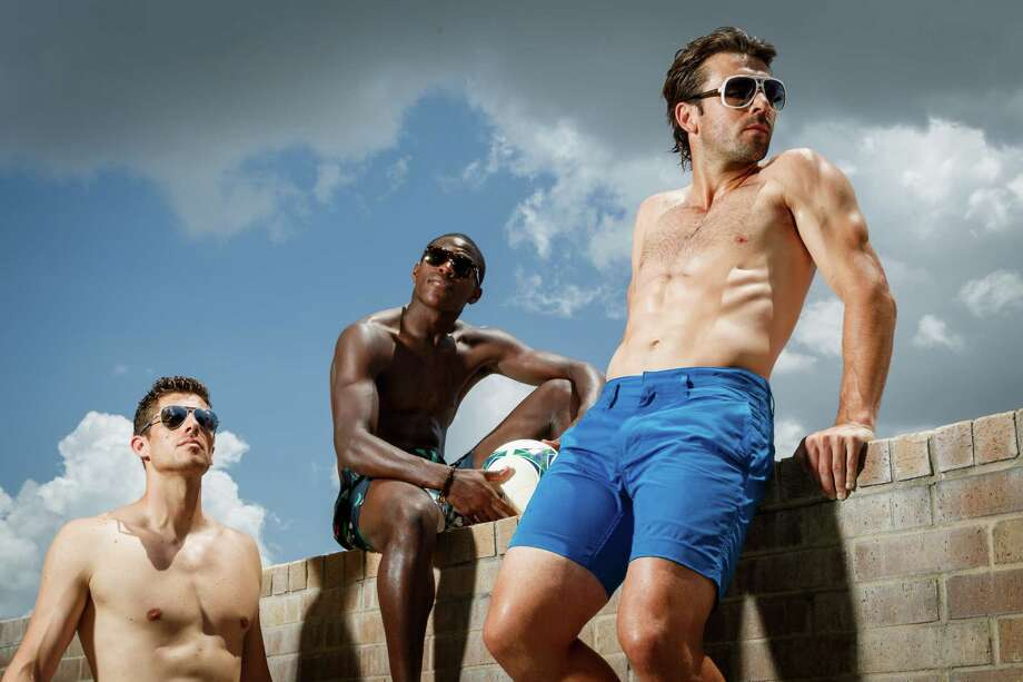 Houston Dynamo soccer players, Tally Hall, Kofie Sarkodie and Mike Chabala model men's swimwear at the Four Seasons Hotel Houston, Monday, June 24, 2013, in Houston. ( Michael Paulsen / Houston Chronicle ) Photo: Michael Paulsen, Staff / © 2013 Houston Chronicle