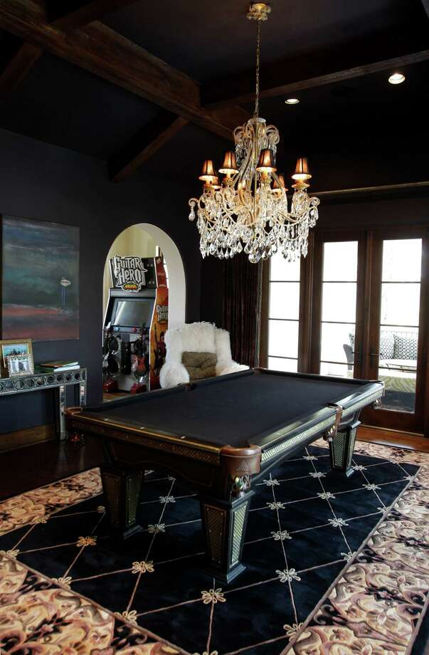Much of the opulent upstairs space is dedicated to having fun, with a pool table, arcade games and a foosball table. Photo: Melissa Phillip, Staff / © 2013  Houston Chronicle