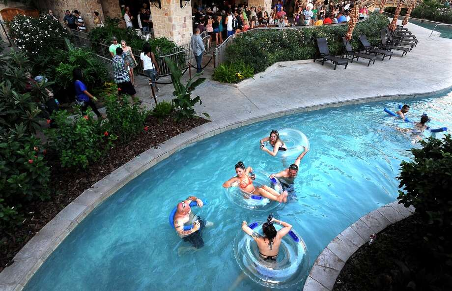 Partiers float down the lazy river during the Liquid Society party a L'Auberge in Lake Charles, Thursday, July 26, 2012. Tammy McKinley/The Enterprise