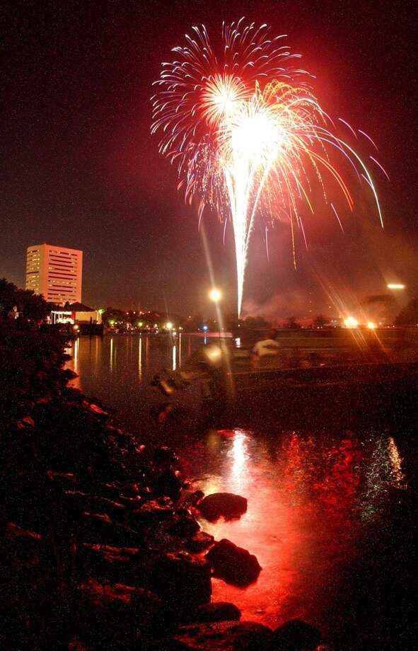 Beaumont residents and guests watch the city's fireworks display from both Riverfront Park and the Neches River on July 4, 2005.Jefferson County commissioners were expected to rule Monday  on whether there will be a full or partial ban on Fourth of July fireworks in the county. Enterprise file photo