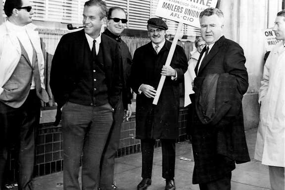 From left to right, Chronicle Columnist Art Hoppe, with pipe, Chronicle Columnist Herb Caen, dark glasses, Dwight Newton, TV columnist, Walt Daley, Examiner Sports Reporter, on the picket line at 5th and Mission during the 1968 newspaper strike.