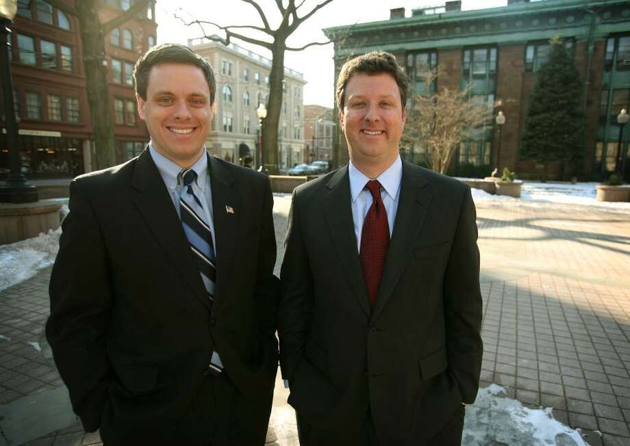 State Sen. Dan Debicella, left, and former State Sen. Rob Russo on McLevy Green in downtown Bridgeport. The two men, both Republicans and good friends, plan to challenge Congressman Jim Himes in the November election. Photo: Brian A. Pounds / Connecticut Post