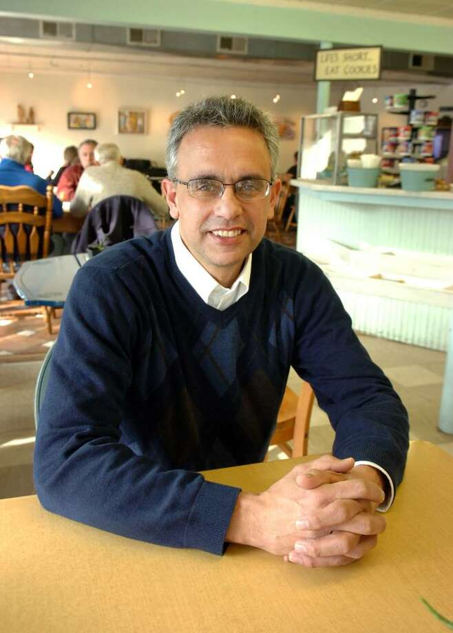 Rick Torres sits in the Harborview Market, the buisiness he owns in the Black Rock section of Bridgeport, Conn. Jan. 15th, 2010. Torres, a Republican, ran for mayor in 2003, and intends to run for congress this year. Photo: Ned Gerard / Connecticut Post