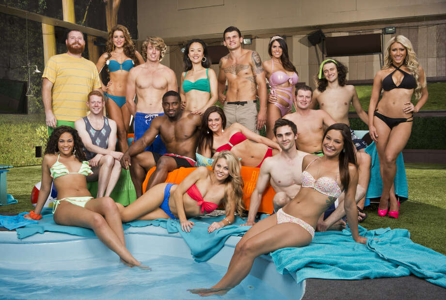 """Big Brother"" houseguests pose by the pool. Contestant Jessie Kowalski (sitting, lower far right) is from San Antonio. Photo: CBS / Getty Images"