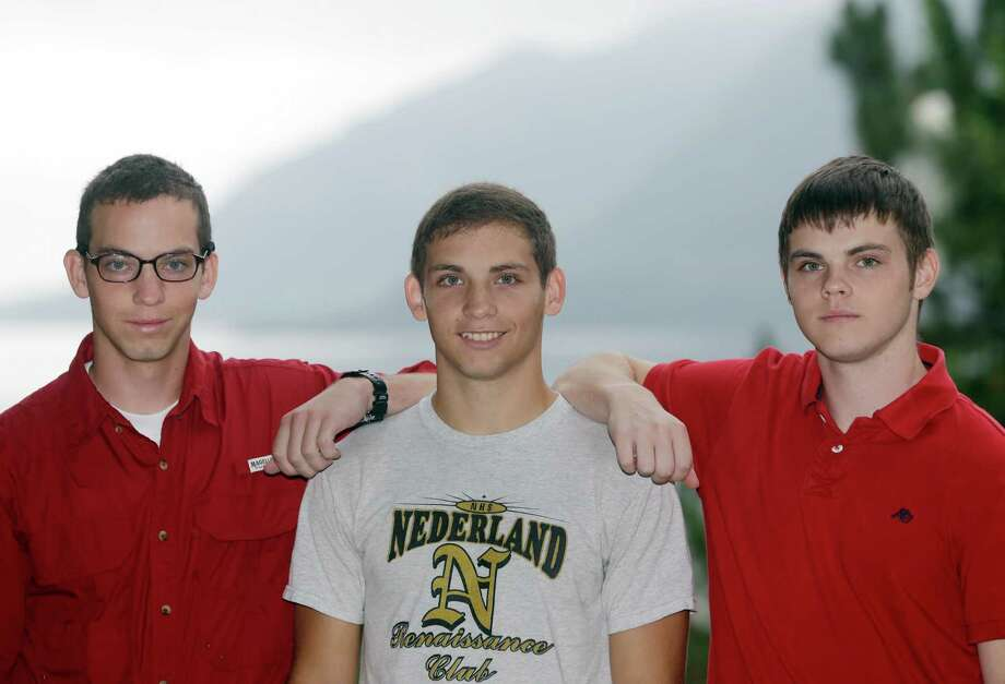 From left, brothers Noah Ogrydzniak, 19, and twins Sumner and Cole, 17, of Nederland, Texas, pose during Reception Day at the U.S. Military Academy at West Point on Monday, July 1, 2013, in West Point, N.Y. For one of the few times in its long history, the U.S. Military Academy has accepted three siblings into the same class. (AP Photo/Mike Groll) Photo: Mike Groll, STF / AP