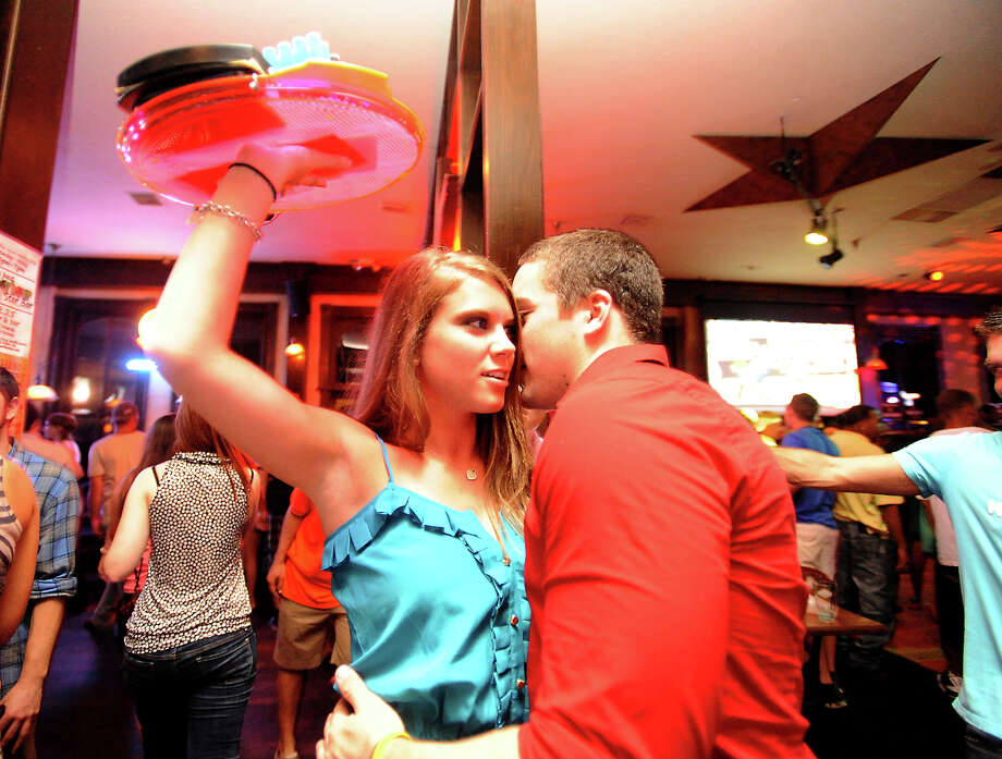 Morgan Talbot socializes with customers at The Star Bar in Beaumont, Thursday. Tammy McKinley/The Enterprise Photo: TAMMY MCKINLEY