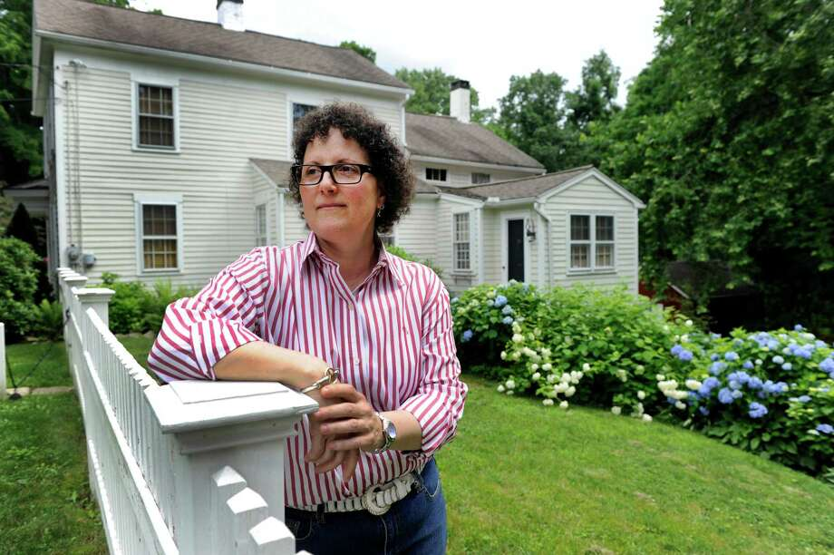 Jacqueline Salame, 52, of Brookfield, Conn., is the Historic District Commission chairman for Brookfield.  She is photographed at her Revolutionary War era home in Brookfield's Historic District, Wednesday, July 3, 2013. Photo: Carol Kaliff / The News-Times
