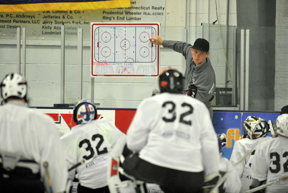 Hamden native Jonathan Quick, goalie for the NHL's Los Angeles Kings, gives instructions to students at his goalie camp at Stamford Twin Rinks on Tuesday,. Photo: Jason Rearick / Stamford Advocate