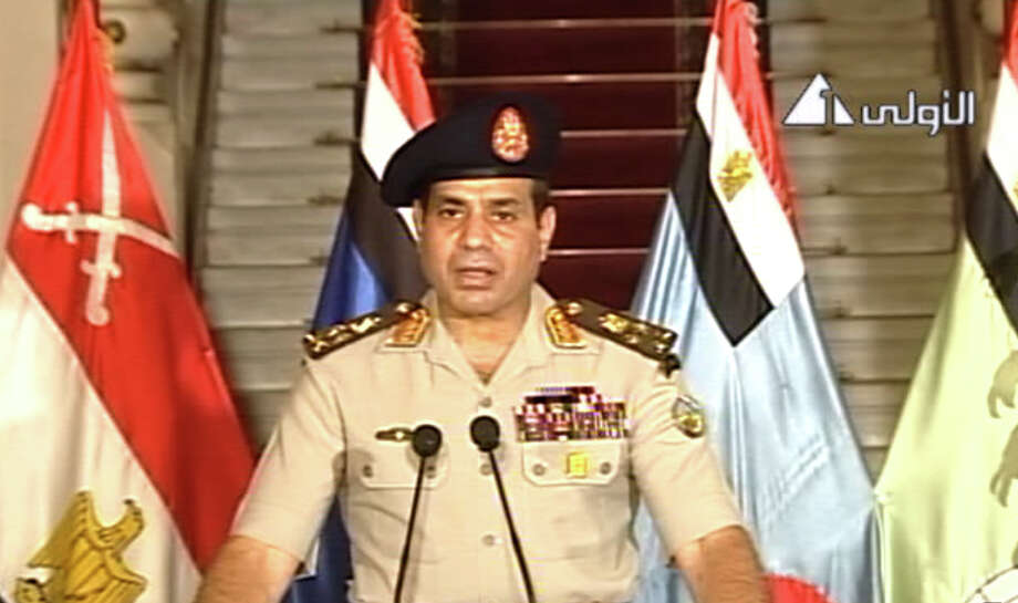 This image made from video shows Lt. Gen. Abdel-Fattah el-Sissi addressing the nation on Egyptian State Television Wednesday, July 3, 2013. Egypt's military chief says president is replaced by chief justice of constitutional court. Photo: Egyptian State Television