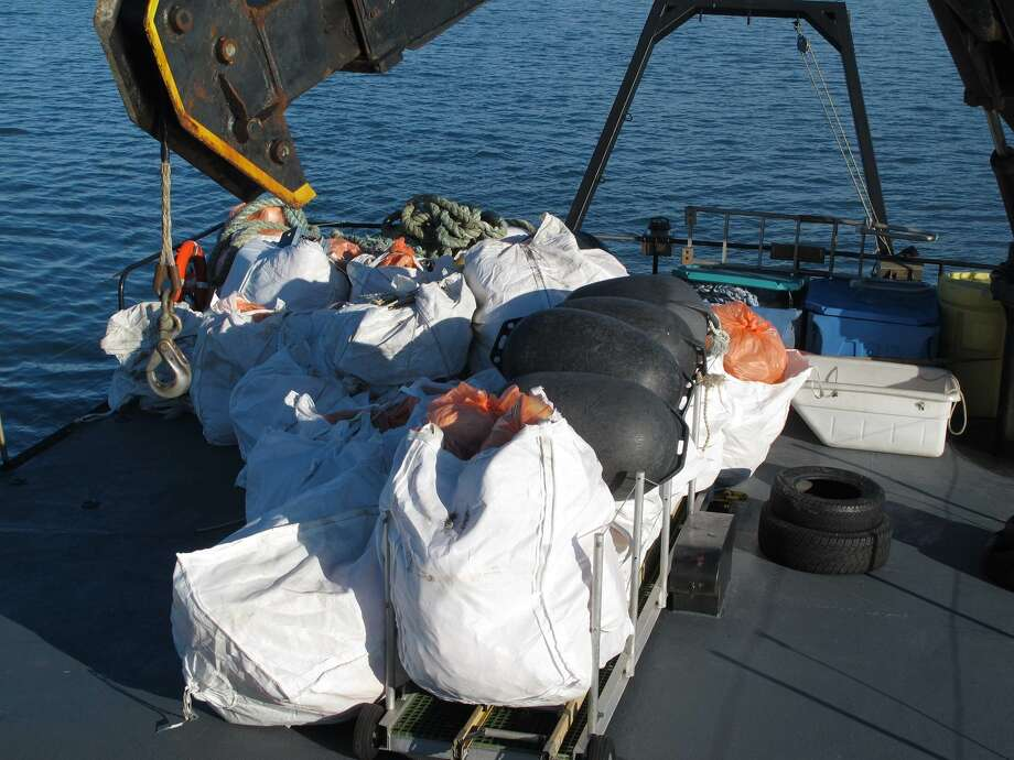 4000 pounds of debris hauled from Hallo Bay onto the Norseman. Photo: Nicholas Mallos/Ocean Conservancy