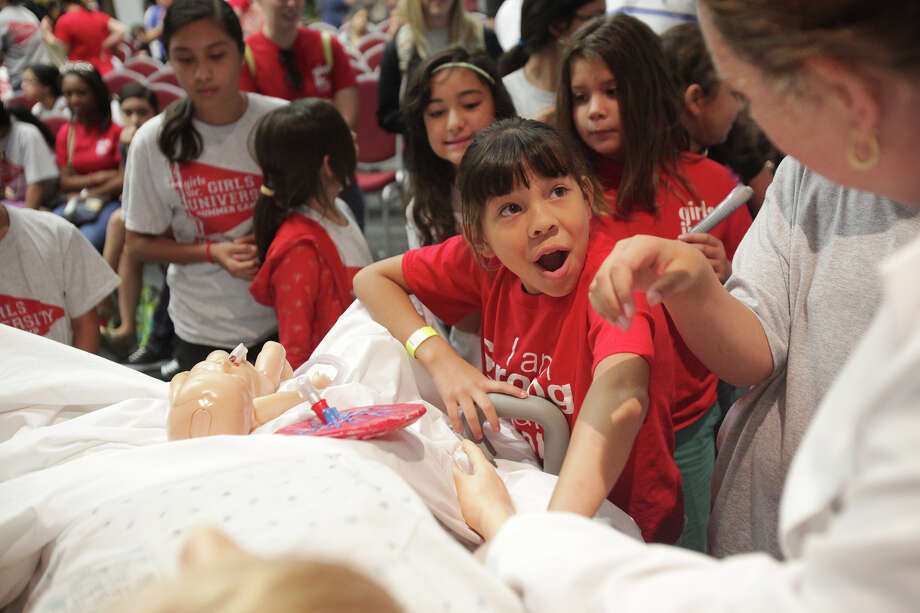 Janine Martinez, 11 of San Antonio, feels the pulse of Noelle the mannequin at St. Philips College in San Antonio on Wednesday, July 3, 2013. Computerized mannequins used by nursing students at the college demonstrated to participants a mother delivering a newborn, as well as the effects of alcohol baby syndrome, shaken baby syndrome, and drug affected babies. Photo: Abbey Oldham, San Antonio Express-News / © San Antonio Express-News