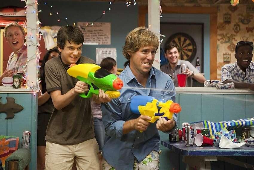 Duncan (Liam James, left) finds a haven at an aging amusement park where Roddy (Nat Faxon) works.