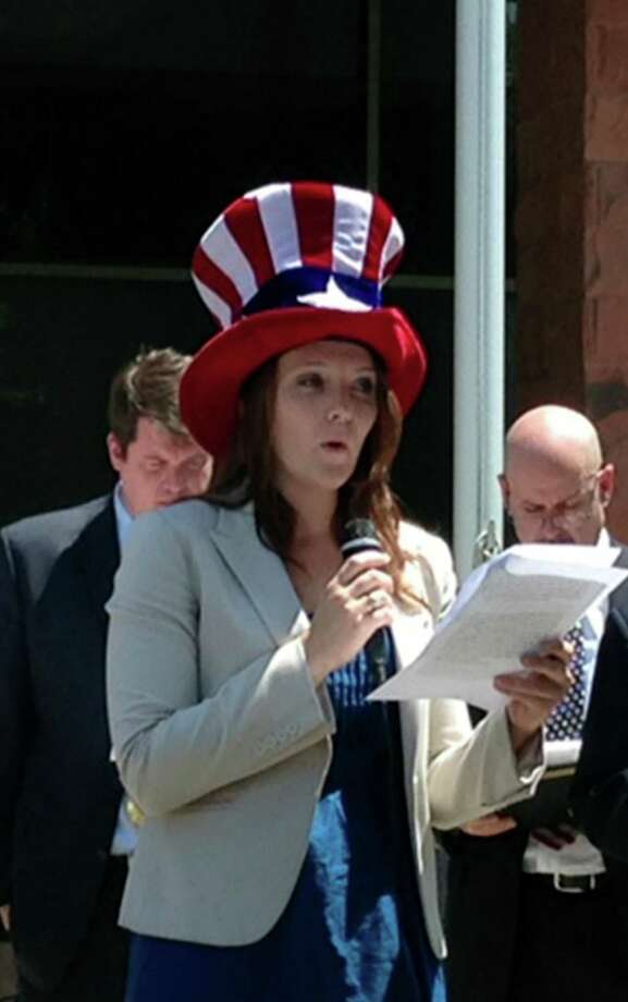 Texas Criminal Defense Lawyers Association Member Megan Roper reads the Declaration of Independence Wednesday in front of the Paul Elizondo Tower at the courthouse complex. Photo: Sam M Peshek, San Antonio Express-News / San Antonio Express-News