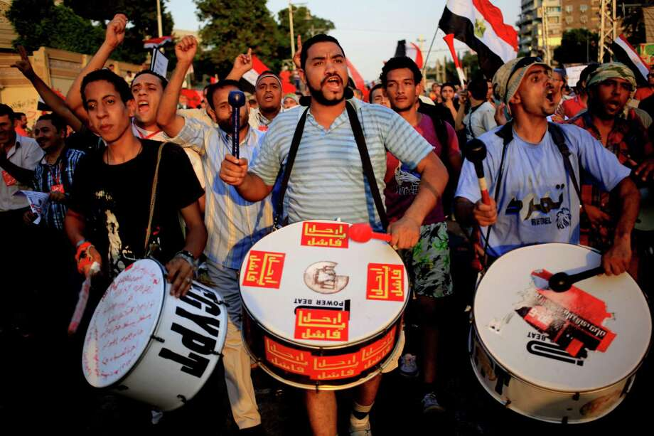"""Opponents of Egypt's Islamist President Mohammed Morsi bang drums during a protest outside the presidential palace, in Cairo, Egypt, Tuesday, July 2, 2013. Egypt was on edge Tuesday following a """"last-chance"""" ultimatum the military issued to Mohammed Morsi, giving the president and the opposition 48 hours to resolve the crisis in the country or have the army step in with its own plan. Photo: Khalil Hamra"""